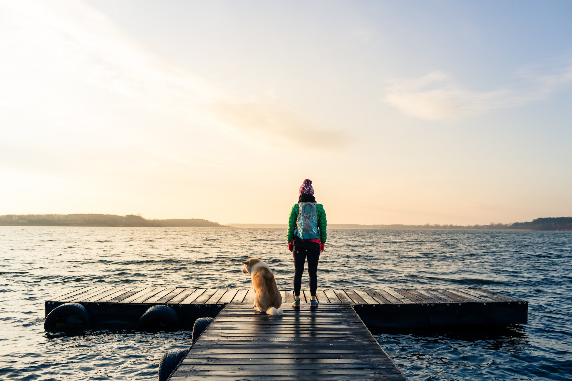 Image of woman and dog on a dock