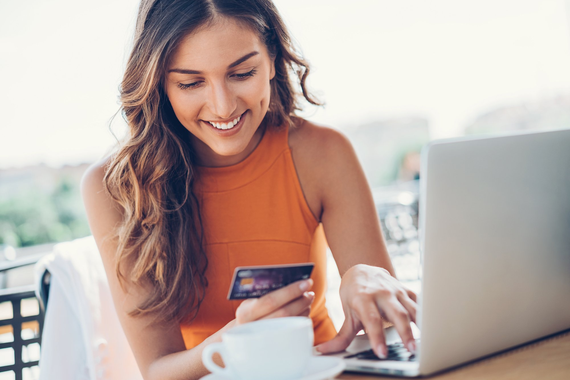 Image of woman with credit card